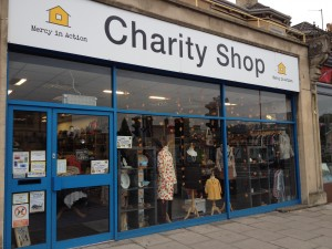 Clean and bright windows cleaning alot of windows on a commercial Bath charity shop