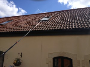 Clean and bright windows cleaning a high window on a Bath property
